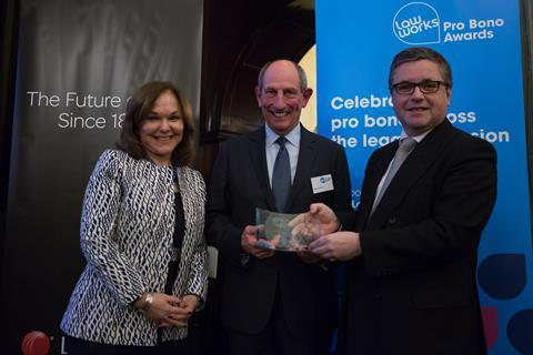 Outstanding Contribution to Pro Bono Michael Napier QC receiving his award from Solicitor General Robert Buckland QC MP and Hilarie Bass (President, American Bar Association)